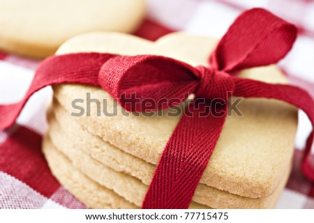 Heart shaped cookies with a red ribbon - stock photo