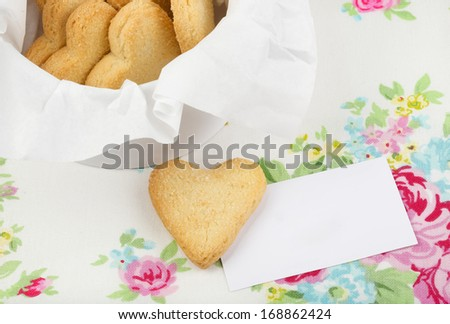 Heart shaped cookies with business card on the colorful background - stock photo