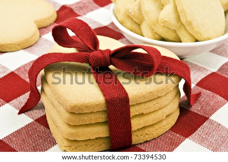Heart shaped cookies with red ribbon on cloth - stock photo