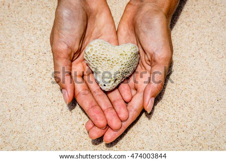 Heart shaped coral in hands, Boracay Island, Philippines