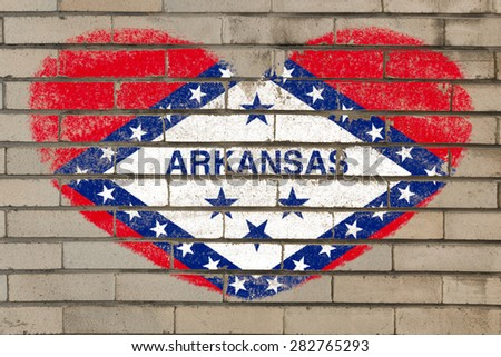 heart shaped flag in colors of arkansas on brick wall