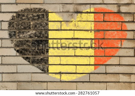 heart shaped flag in colors of Belgium on brick wall