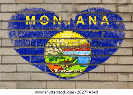 heart shaped flag in colors of montana on brick wall - stock photo