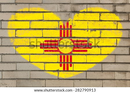 heart shaped flag in colors of new mexico on brick wall
