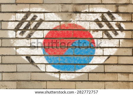 heart shaped flag in colors of South Korea on brick wall