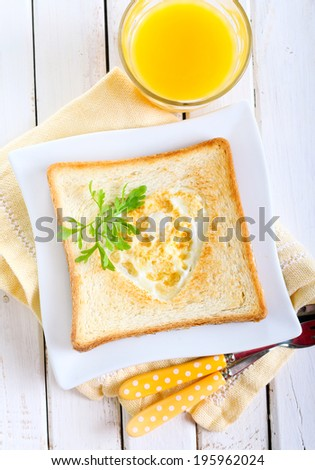 Heart shaped fried egg in toast