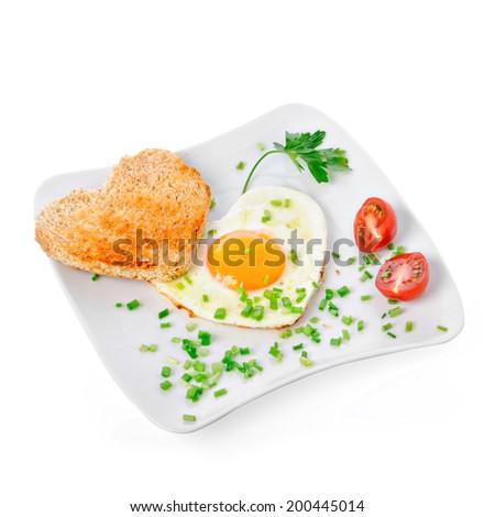 Heart shaped fried egg with toast - stock photo