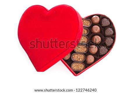 Heart shaped gift box having chocolates - stock photo