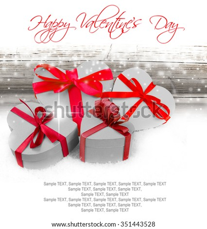 Heart shaped gifts on wooden background with white space for text