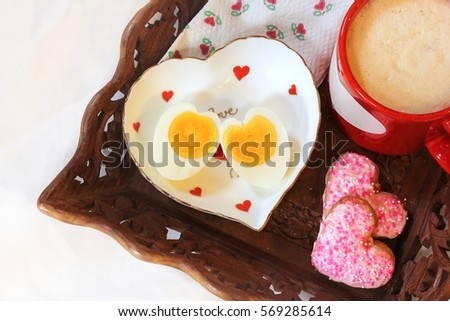 heart shaped hard boiled egg served with coffee latte day breakfast in bed concept