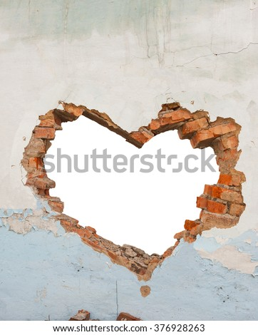 Heart shaped hole in old brick wall