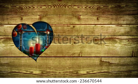 heart shaped hole in wood showing a winter scene - stock photo