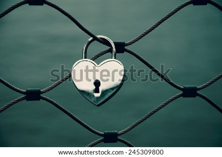 Heart shaped love padlock in Paris. Valentine's day background. Aged photo. - stock photo