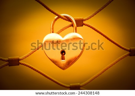 Heart shaped love padlock in Paris. Valentine's day background. Toned photo. Vignette. - stock photo