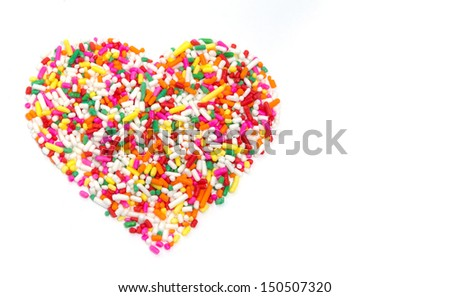 Heart shaped made from colored sprinkles - stock photo
