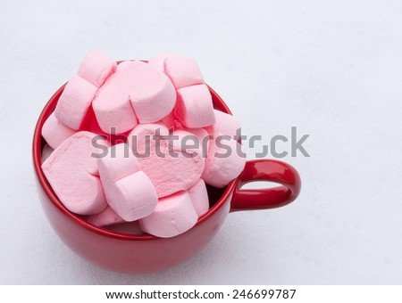 Heart shaped marshmallows on white background