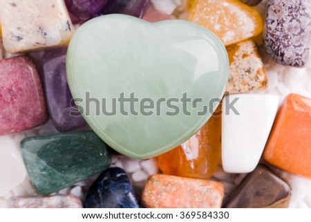 heart-shaped natural stone with other stones - stock photo