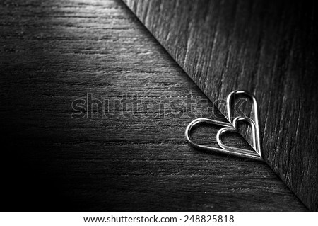 Heart shaped paper clip with reflextion - stock photo