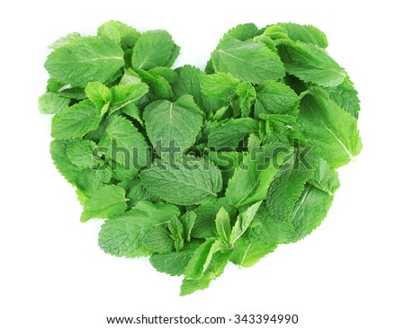 Heart shaped pile of mint isolated on white - stock photo