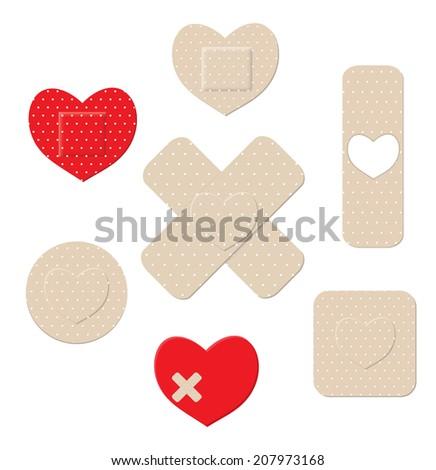 Heart shaped plastic bandages, illustration - stock photo