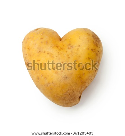 Heart Shaped Potato Isolated on a White Background.