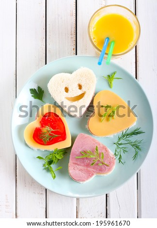 Heart shaped sandwiches on plate - stock photo