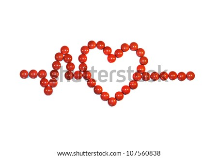 Heart shaped symbol created using red pills for health concepts - stock photo