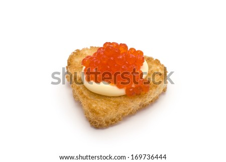 Heart-Shaped Toast with Red Caviar on White Sauce isolated on white - stock photo