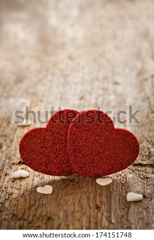 heart shapes on wooden background