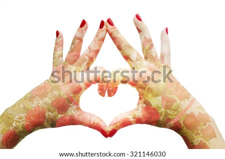 Heart sign with female hands and double exposure roses - stock photo