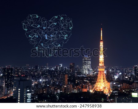heart sparkle Fireworks celebrating over Tokyo cityscape at night, Japan - stock photo