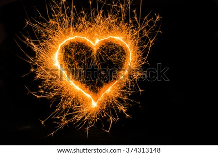heart sparkle, Valentines day. duo heart gold color. Sparklers heart, Heart of sparklers on black background,love and light.fire and flame. - stock photo