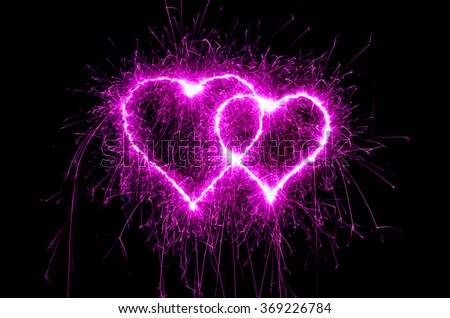 heart sparkle, Valentines day heart pink color. Sparklers heart,  Heart of sparklers on black background,love and light. - stock photo