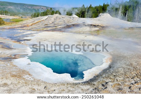 Heart Spring steaming geyser in Upper Geyser basin of Yellowstone National Park, Wyoming - stock photo