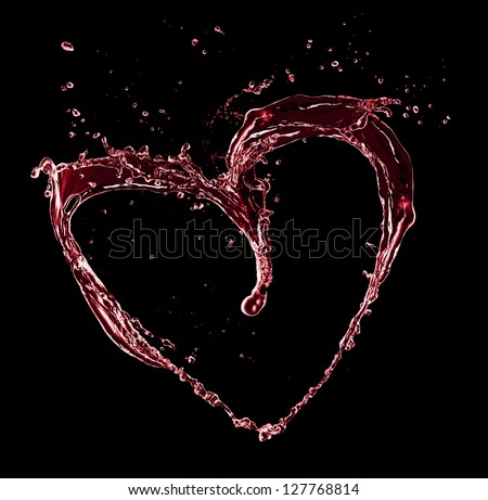 Heart symbol made of water splashes, isolated on black background