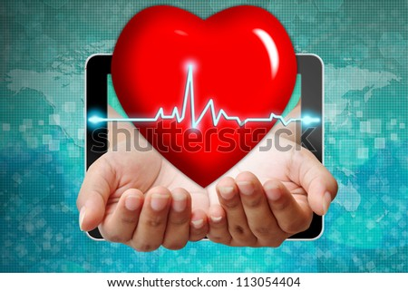Heart symbol on hand pushing out of tablet-pc - stock photo
