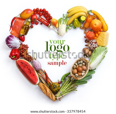 Heart symbol / studio photography of heart made from different fruits and vegetables - on white background - stock photo