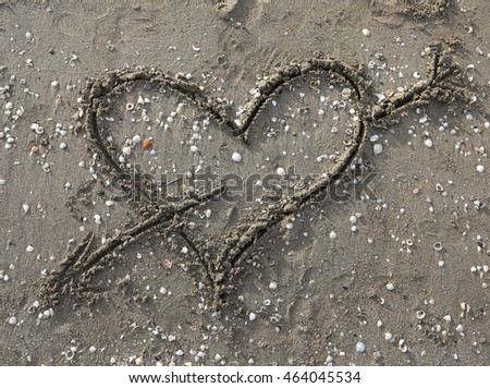 heart symbol with arrow on the Beach