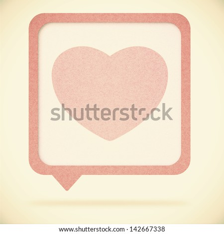 Heart tag recycled paper on vintage tone  background - stock photo