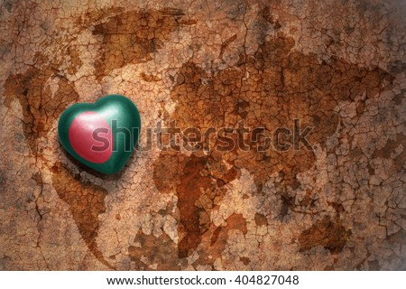 heart with national flag of bangladesh on a vintage world map crack paper background. concept - stock photo