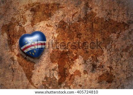 heart with national flag of cape verde on a vintage world map crack paper background. concept - stock photo