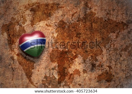 heart with national flag of gambia on a vintage world map crack paper background. concept - stock photo