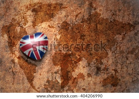 heart with national flag of great britain on a vintage world map crack paper background. concept - stock photo