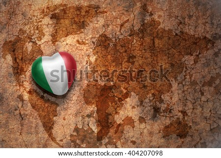 heart with national flag of italy on a vintage world map crack paper background. concept - stock photo