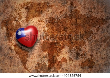 heart with national flag of taiwan on a vintage world map crack paper background. concept - stock photo