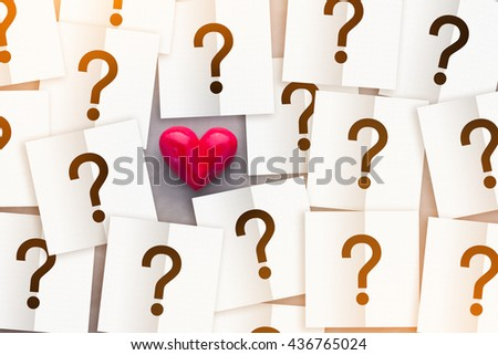 heart with note paper with question mark inside love concept on grey texture background.jpg - stock photo
