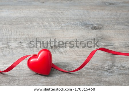 Heart with red ribbon on old wooden, Valentines Day background