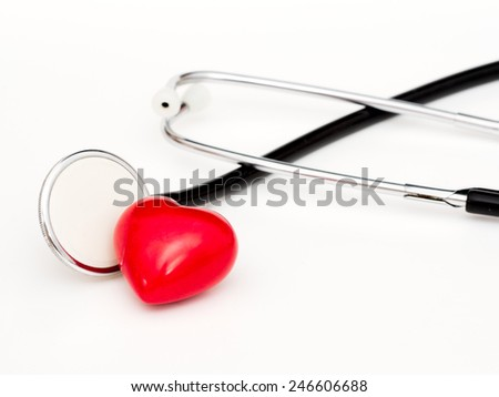 Heart with stethoscope isolated on white background - stock photo