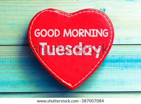 Heart with text Good morning Tuesday. Heart with text Good morning Tuesday on a wooden background. Vintage style. - stock photo