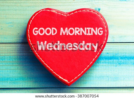 Heart with text Good morning Wednesday. Heart with text Good morning Wednesday on a wooden background. Vintage style. - stock photo